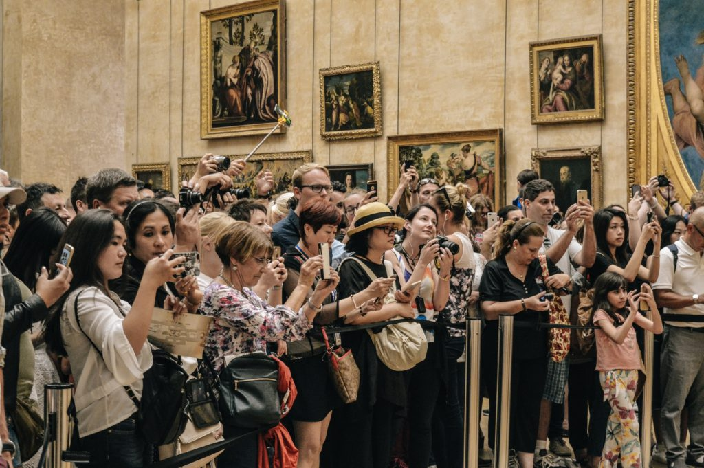 Tourists in line for Mona Lisa, Louvre, Paris, France